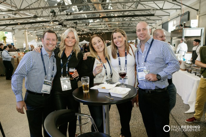 Candid group at Insurance Advisernet Australia Conference 2015 - Trade Show at Princes Wharf No 1 Shed. Photography by Paul Redding, Hobart Trade Show Photographer.