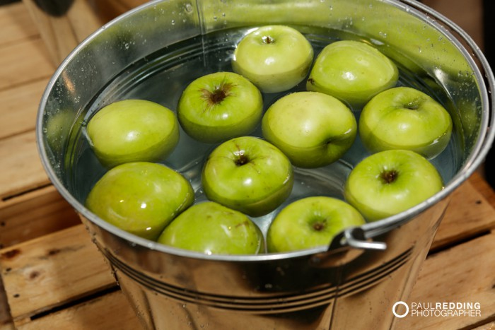 43-  Bobbing for apples at Lark Distillery stand at Insurance Advisernet Australia Conference 2015 - Trade Show at Princes Wharf No 1 Shed. Photography by Paul Redding, Hobart Trade Show Photographer.